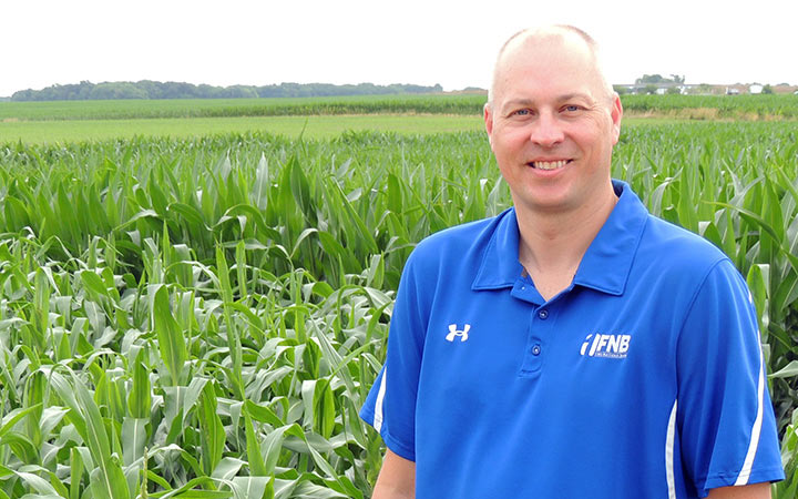 Dusty Bauer standing in a corn field