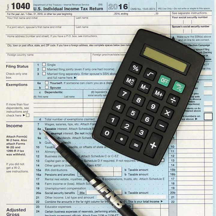 tax form with calculator and pen