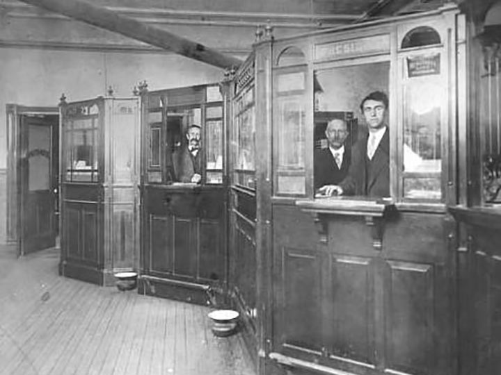 bank employees behind counters in early 1900s