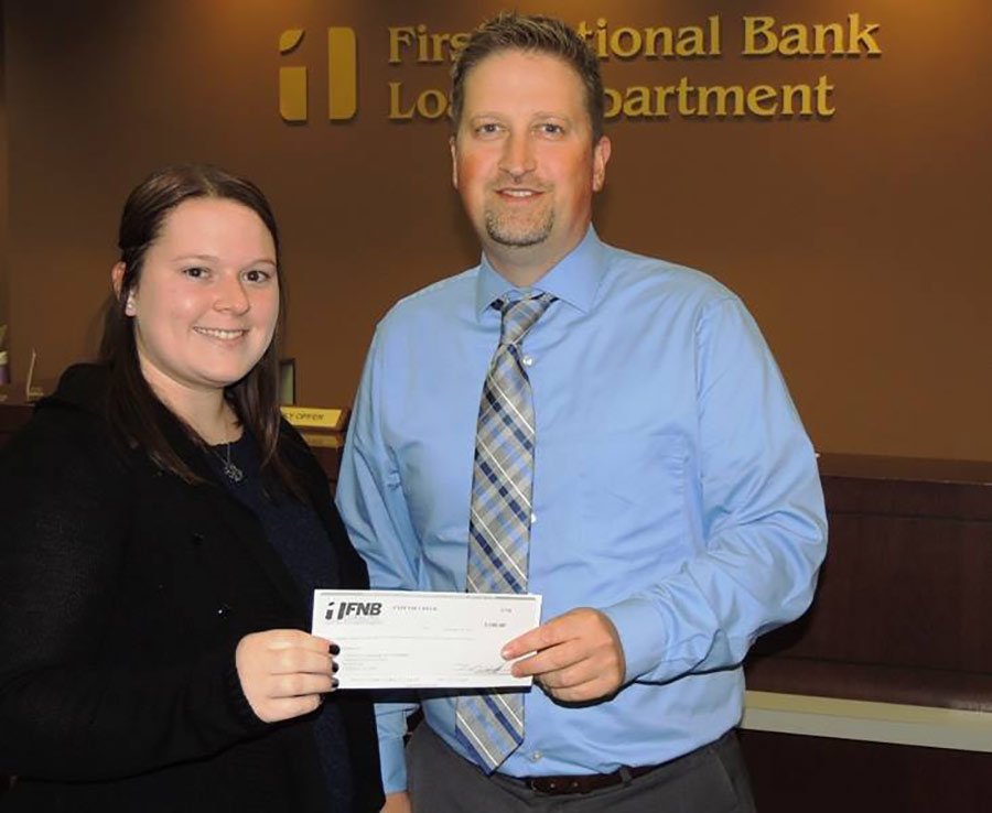 Joe Schaal presenting a check to Brittany Hawkins