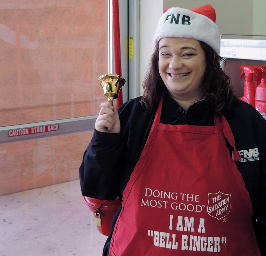 First National Bank employee ringing a Salvation Army bell
